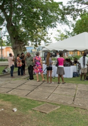 We gathered under a tent and on benches by the Solar House in Queen's Park, Bridgetown.